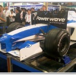 Powerwave booth features a F1 simulation game.